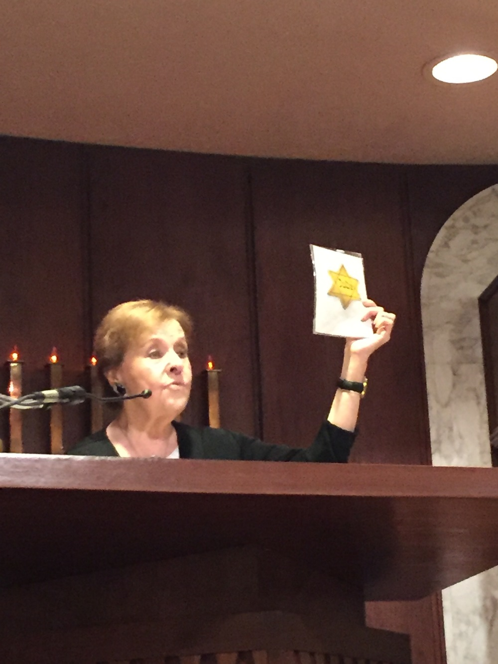 Lazan shows the audience the yellow star the Nazis forced her to wear.