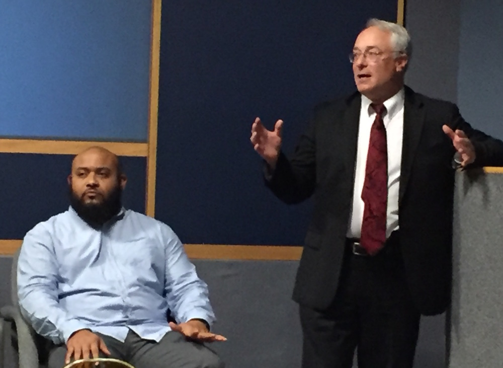 """El Sawyer, left, co-producer of """"Pull of Gravity"""", and Robert Reed, executive assistant U.S. attorney for the Eastern District of Pennsylvania, joined a panel for a criminal justice forum at Wheeling Jesuit University last week.They addressed the issues facing ex-offenders making the transition from prison life to home life."""
