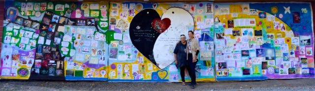 Connie and kelli bickman unveiling the world peace mural at the woodstock peace festival, summer 2015.