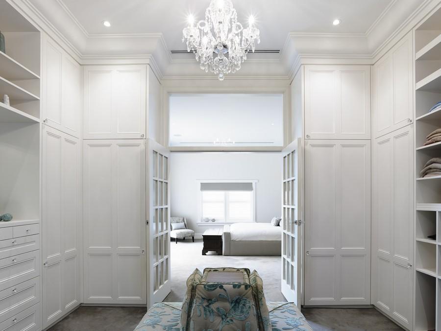 epic-walk-in-closet-design-in-luxury-touch-from-home-interior-design-blogs-elegant-white-chandelier-design-and-floral-motif-bench (1).jpg