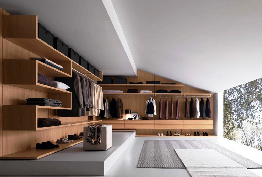 gorgeous-wardrobe-very-modern-wide-walk-in-closet-plan-with-striped-rug-along-with-wooden-wall-shelf-and-sloped-ceiling-and-floor-to-ceiling-glass-wal.jpg