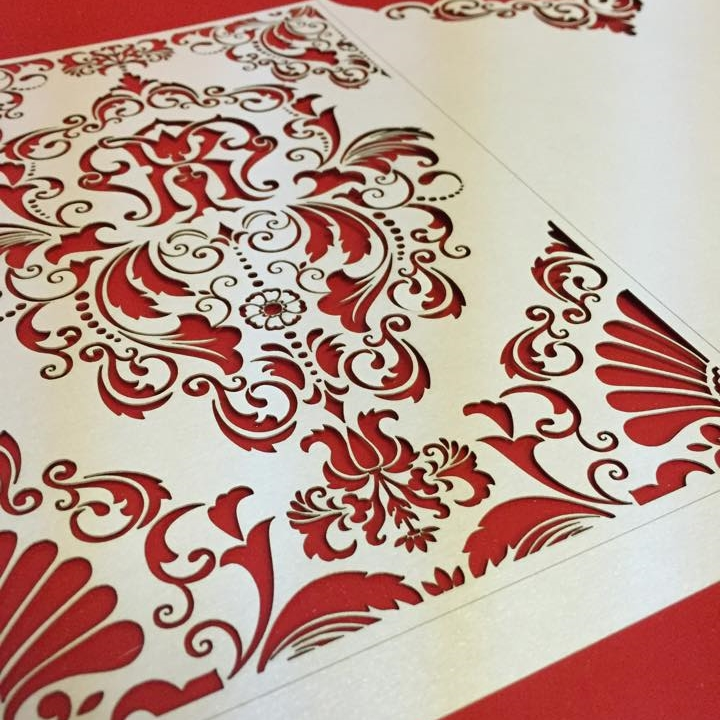 Intricate laser cut pattern on cotton paper.