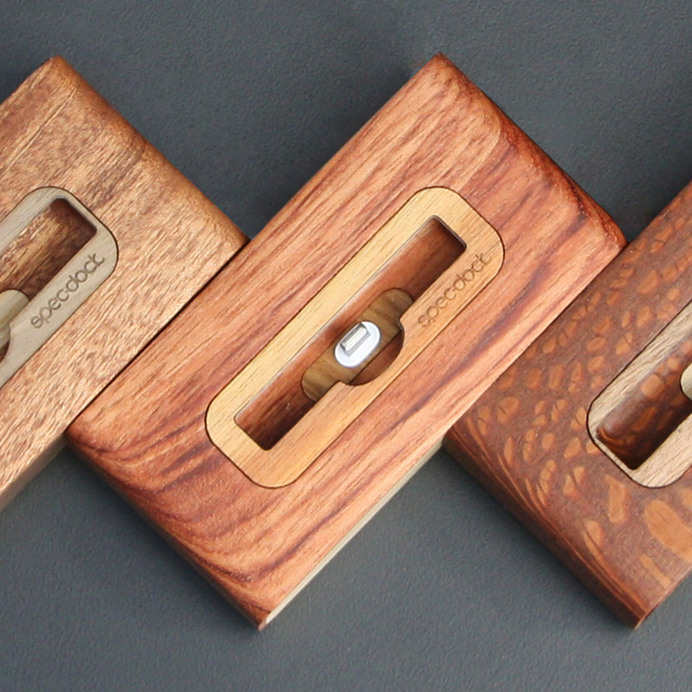 CNC machined wood iPhone docks.