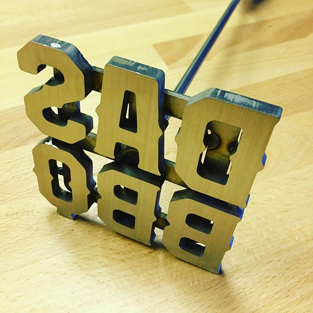Sometimes using a #branding iron is a much more efficient way to get your point across than #laser #engraving - so of course we offer these too! This one was fitted with a custom #walnut handle for use by the customer directly. #2point5 #fabrication #lathe #hardwood #cnc