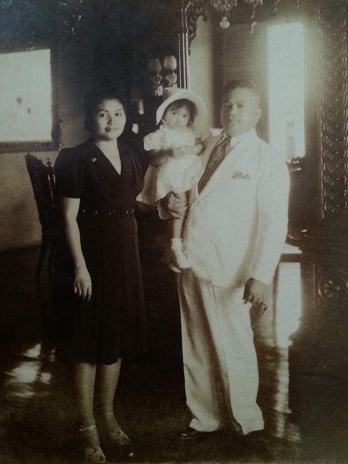 The author's grandparents andher mom, Cynthia, as a toddler.