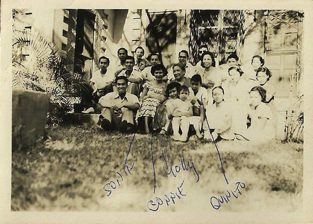 The family  with their cousins in the backyard of the Valley Road house at peacetime, circa 1950. Connie is holding 2-year-old Molly in the front row.