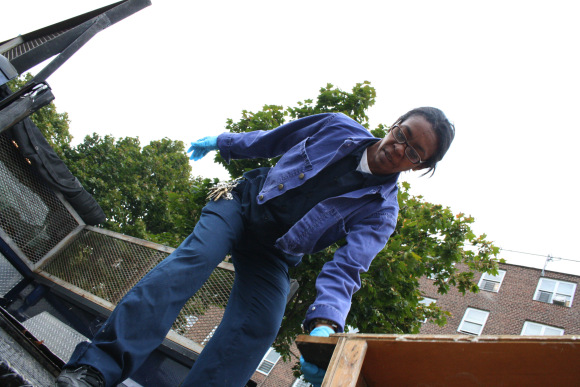 18 October 2011 Originally from Cuba, Bernabeu came to the United States when she was 19 with her father, a former political prisoner in Cuba. In the picture, Bernabeu unloads a cabinet she has to bring into an apartment before a new resident moves in.