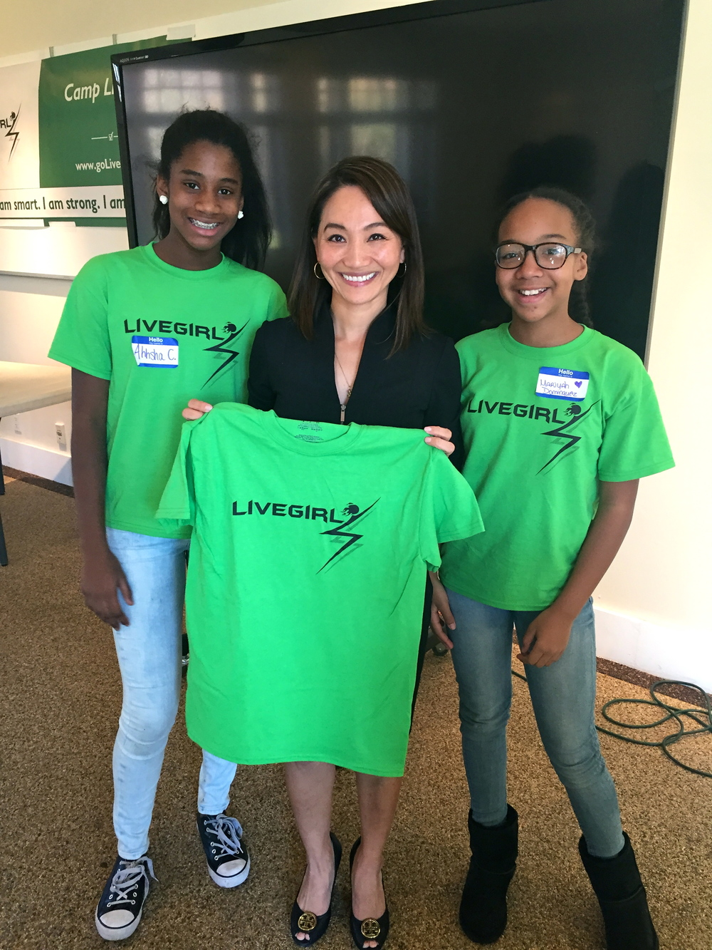 A variety of executive women serve as LiveGirl mentors. Pictured here is Deloitte Partner Elle D'Andrea (middle).