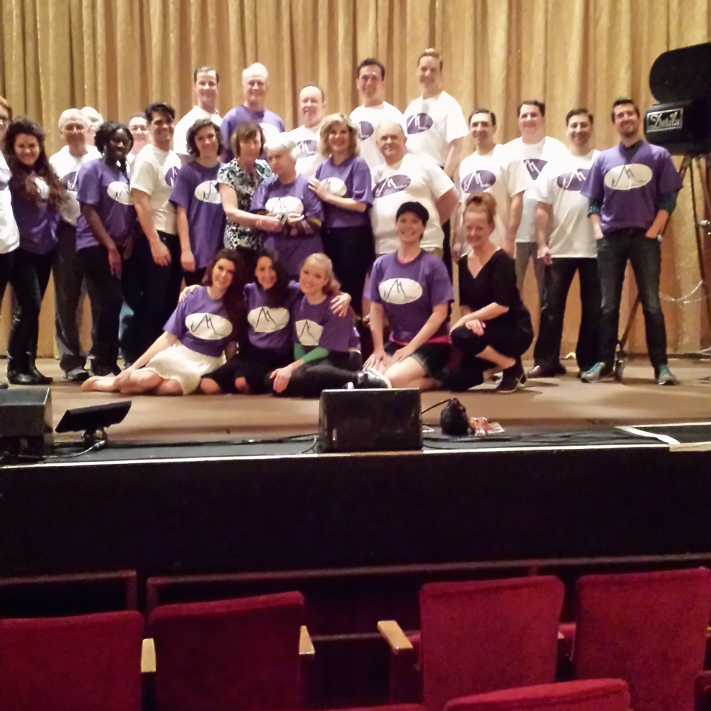 """The cast and crew of the National """"I Love Lucy"""" show during their performance in Cleveland. They are wearing the MindSet shirts in support of Gloria who was an actress for over 25 years.Gloria is in the center standing next to her sister Christine, founder of MindSet."""