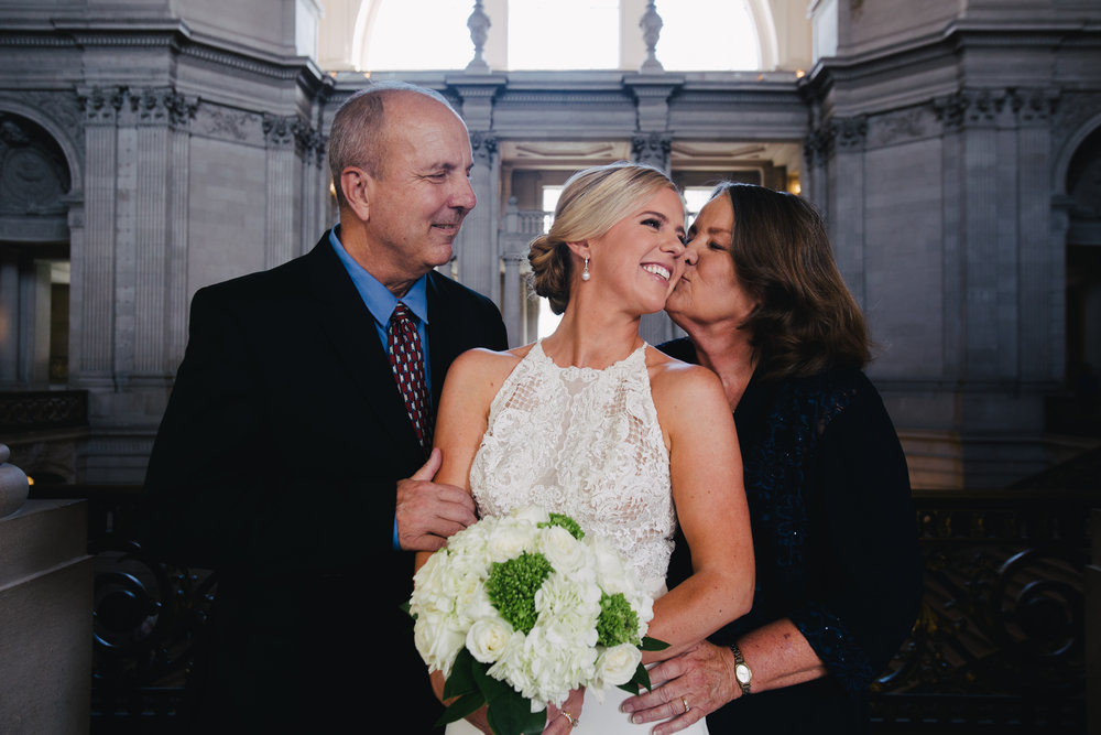 Bride and her parents at San Francisco City Hall