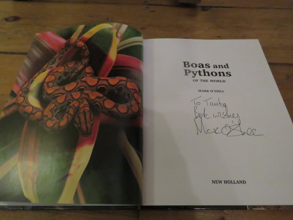 My signed copy of Mark O'Shea's book ' Boas and Pythons of the World' | Credit: Talita Bateman