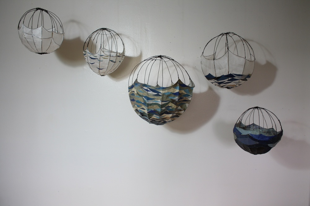 Atlas (five globes), 2011, wire, paper, book covers, dimensions vary