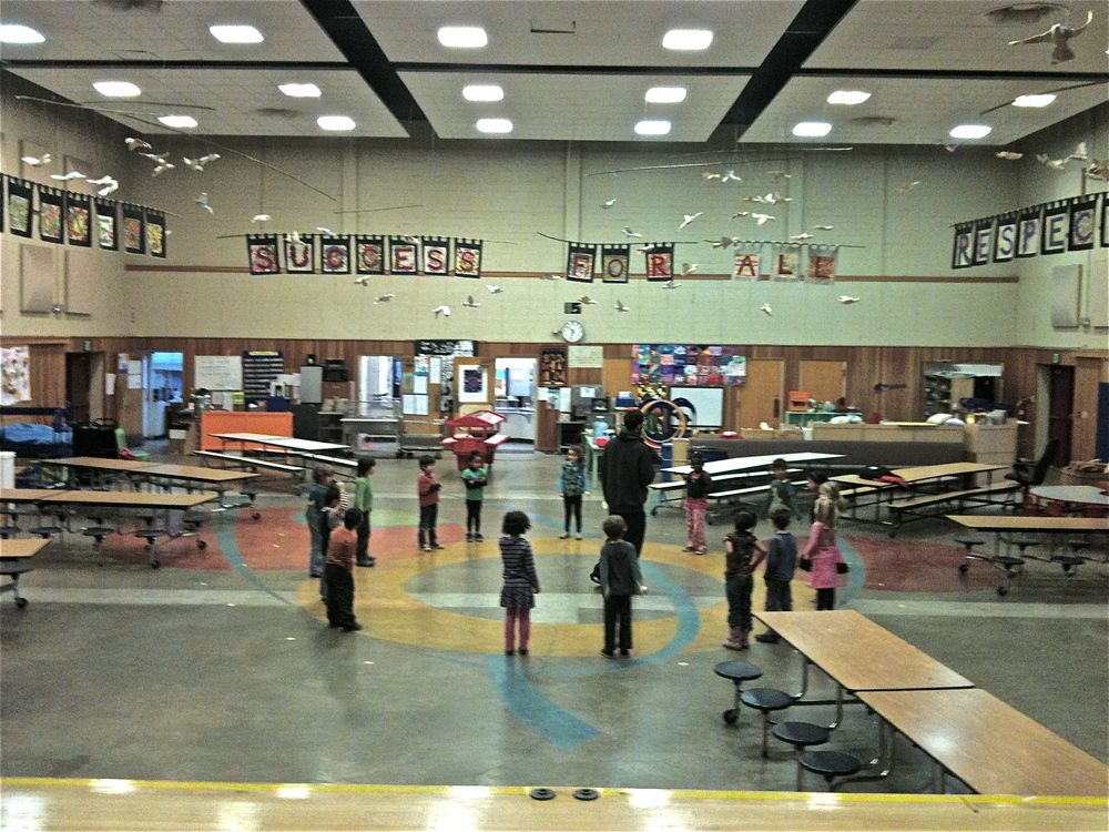 Carved and colored floor in Cafeteria provides a warm and engaging space for indoor P.E. and creative games, performances and meals.