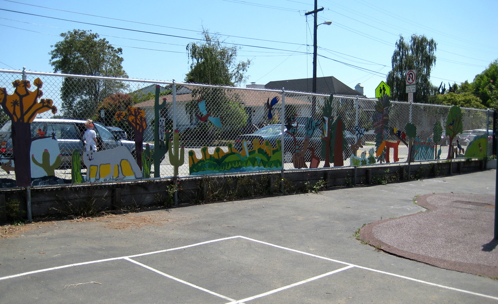 Painted wood cut outs of California flora and fauna decorates playground fencing, Jefferson Elementary School, Berkeley, 2008