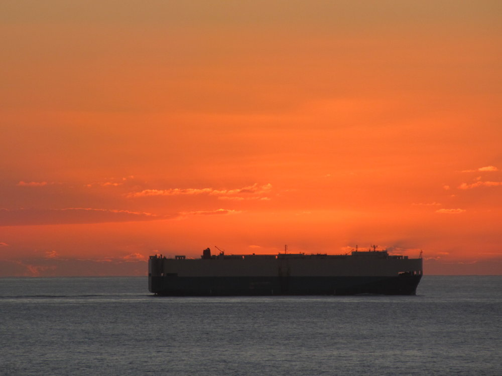 ship covering sunset