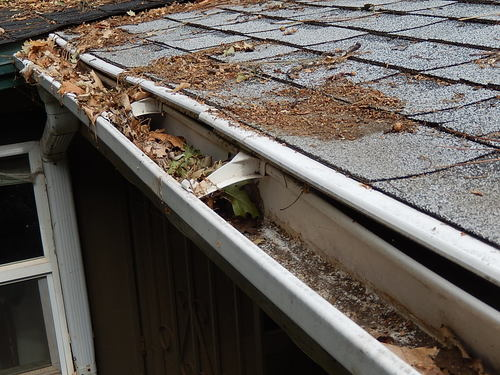 Clean clogged gutters