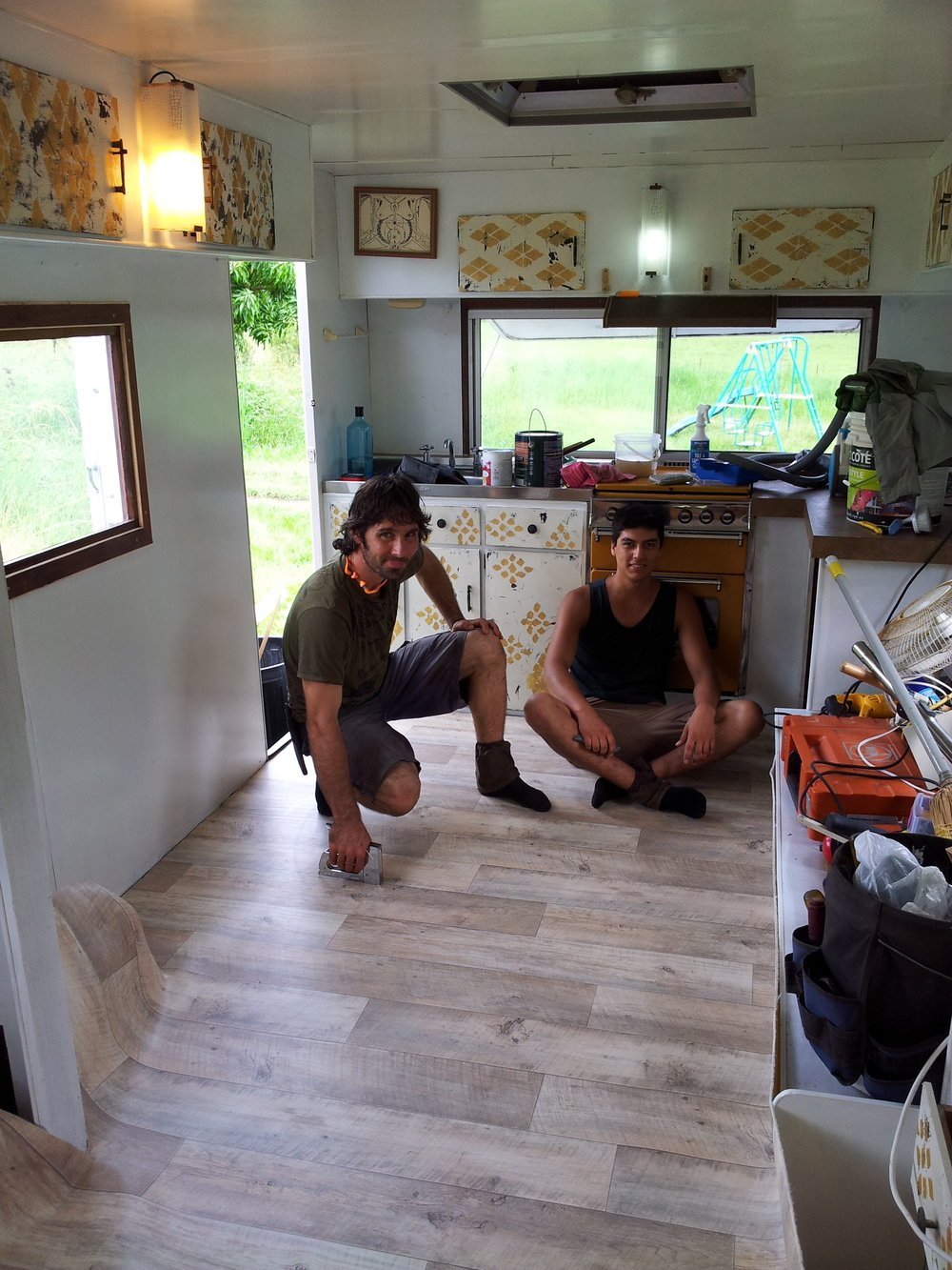 Cyrano and Noah mid renovation on the caravan.
