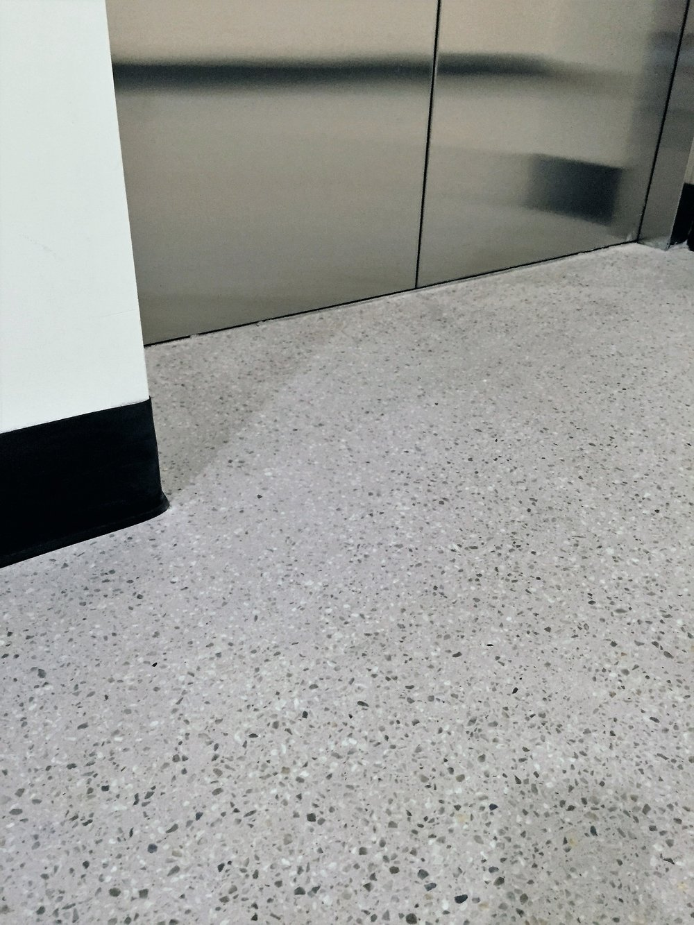 Apartment lobby in Melbourne. Acier with 6mm Dove aggregate. By Policrete.