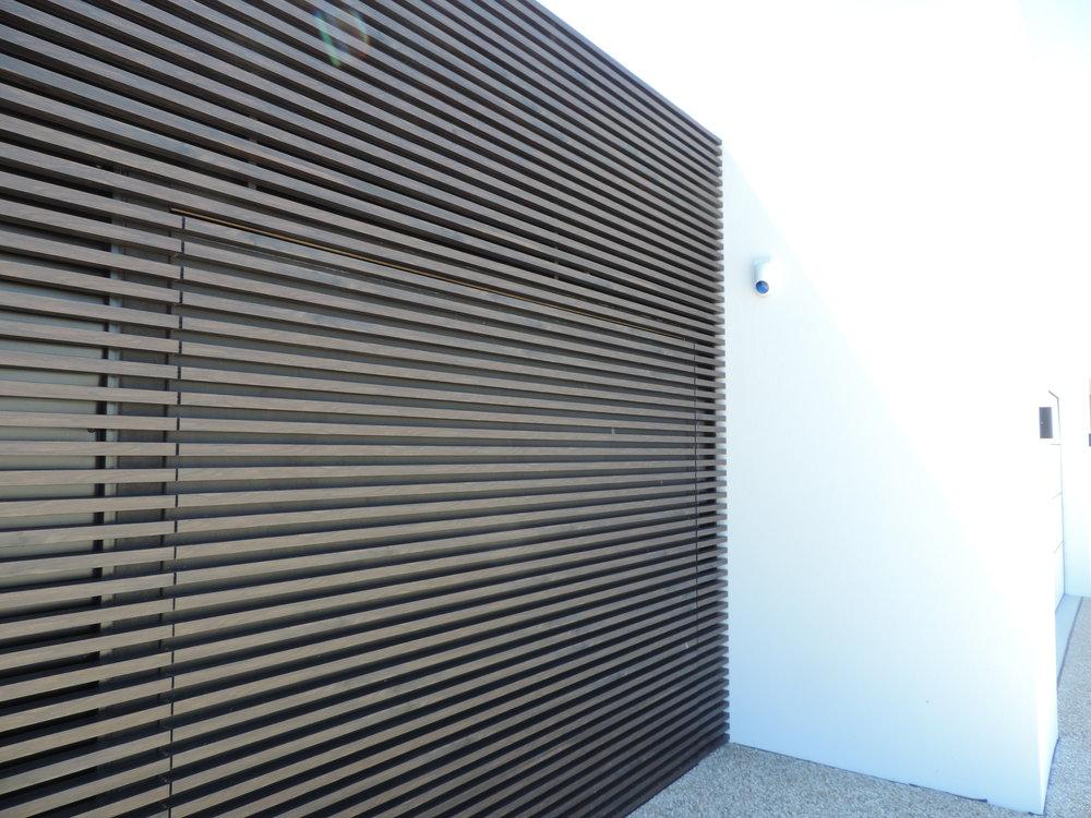 Hidden garage door detail. Kabebari concealed fix system in Burakku Eboni.