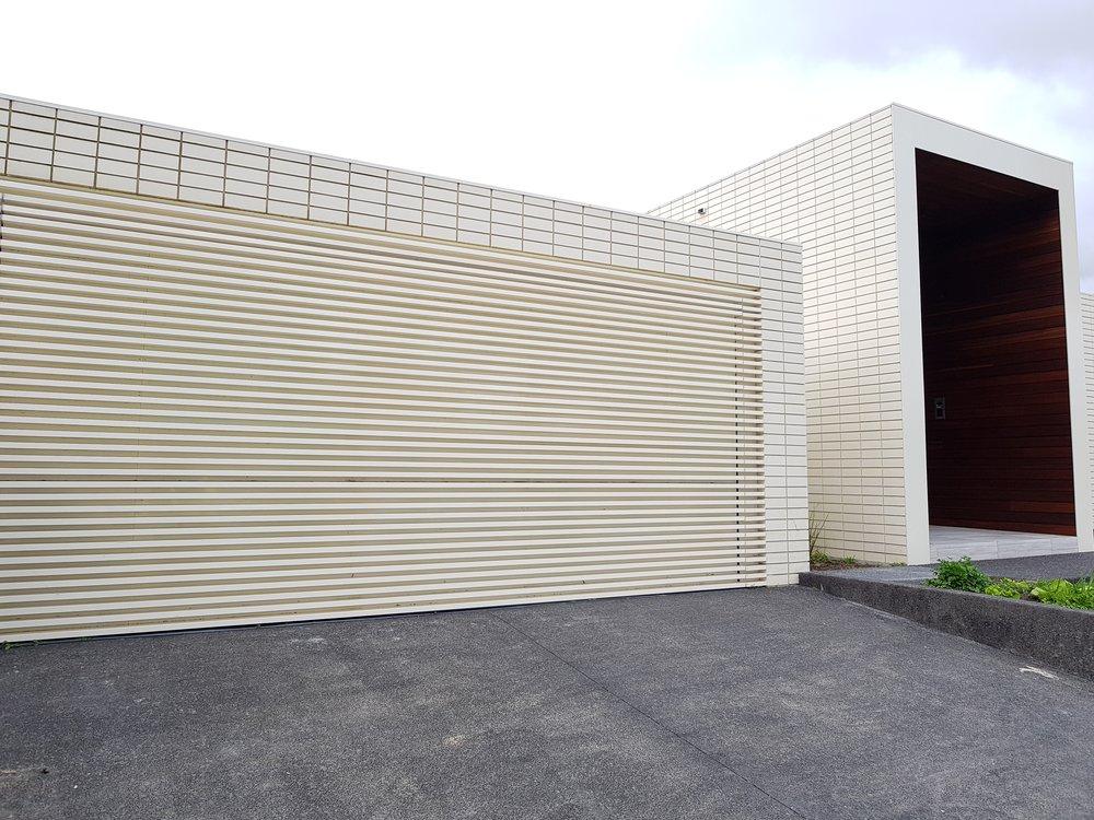 Custom powder coated battens - concealed garage door.