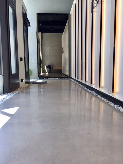 Commercial space - Concrete full bodied sand finish.
