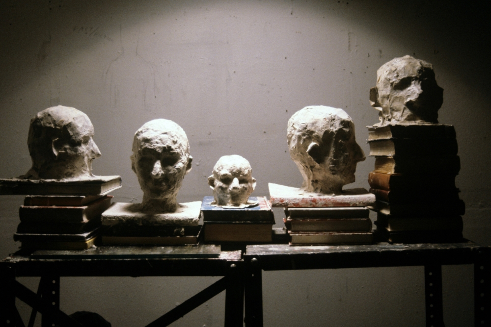 KS91S_Heads_paper mache wax on books.jpg