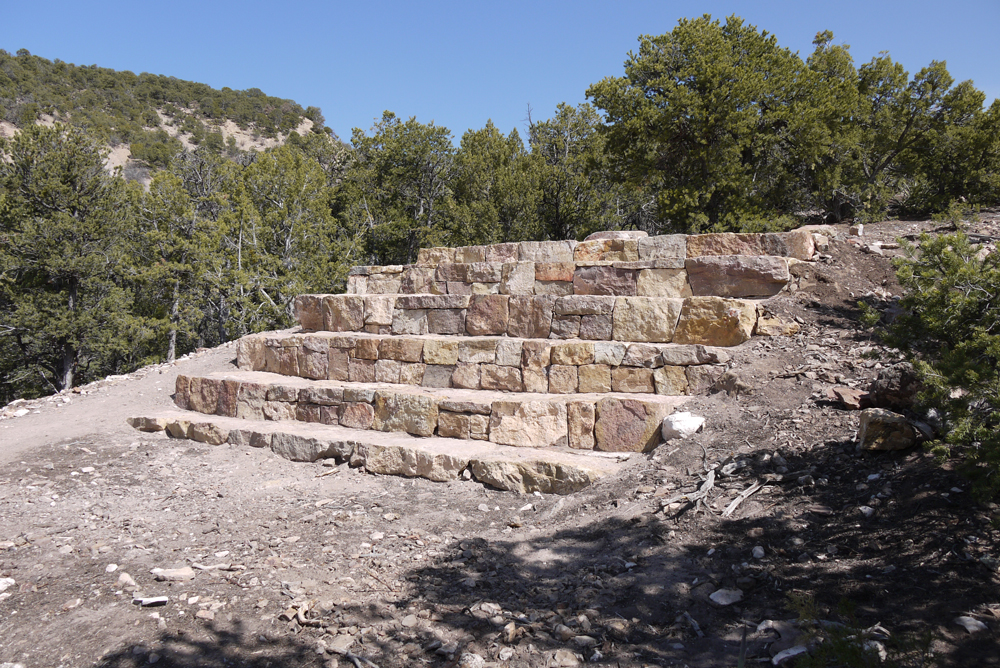 Small Amphitheater, Newspaper Points (outdoor commission for private collection in Santa Fe), stone, steel, aluminum, paint, massive space