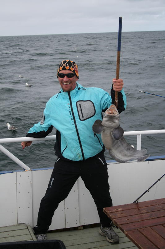 Client with recently caught fish during Sea Angling trip in Reykjavik, Iceland