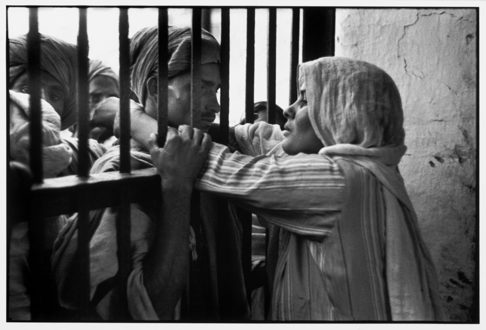 'Woman & Husband Reunited After 10 Months at a Women's Camp - Lahore'  Photo by Henri Cartier Bresson
