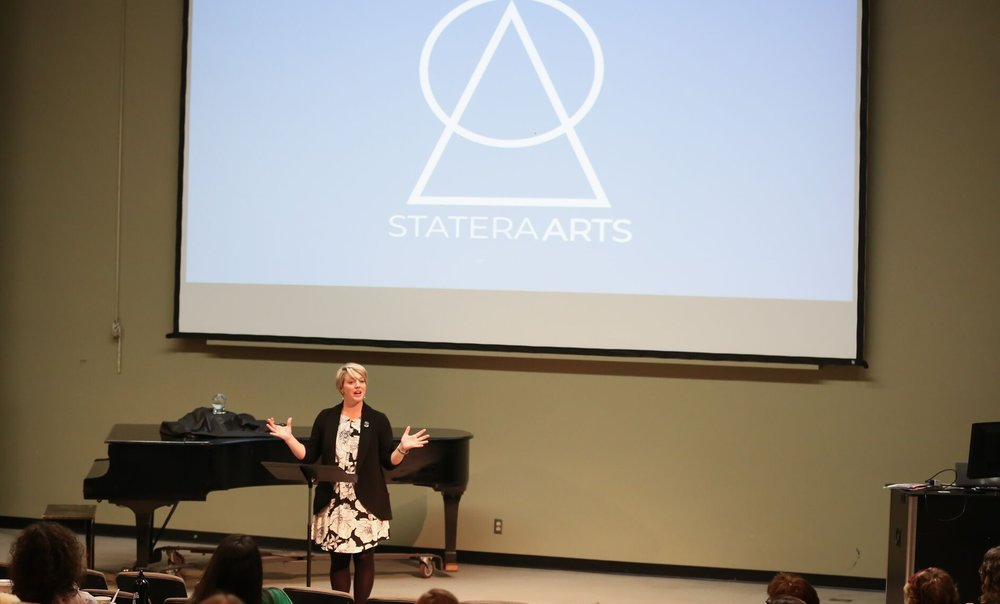 Melinda Pfundstein announcing the StateraArts name change at Statera's National Conference in Milwaukee.