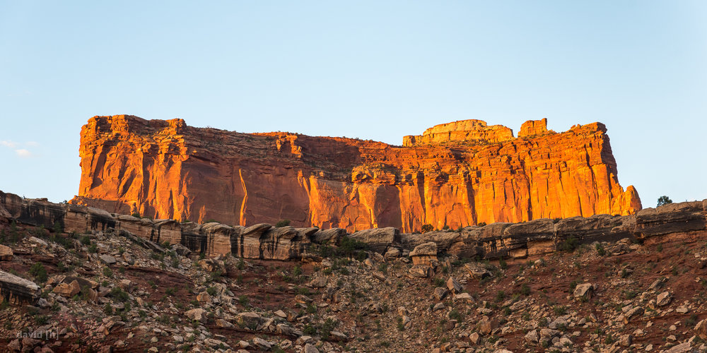 The first light hits the walls of the canyons next to the White Rim Road.