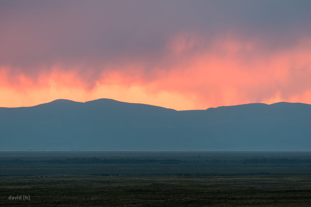 Stunning display of colour through the rainy clouds during sunset at Great Sand Dunes National Park.