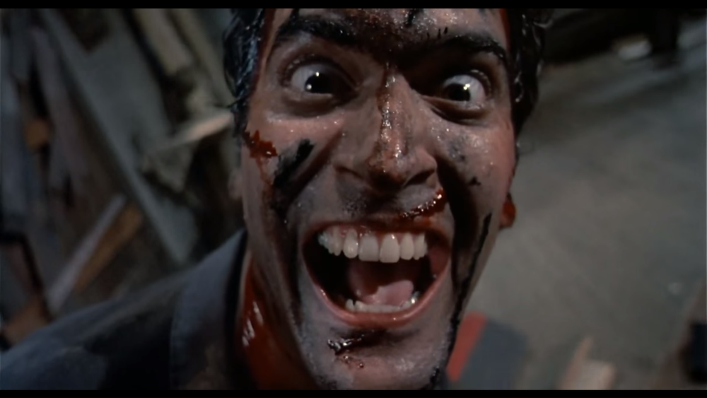 Ash from  Evil Dead 2  (1987) celebrating life.