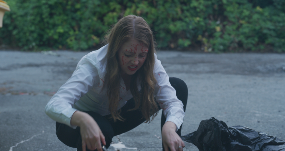 Aleita Northey as Anna Gowan, picking up guts in episode 4 of  This Blows.