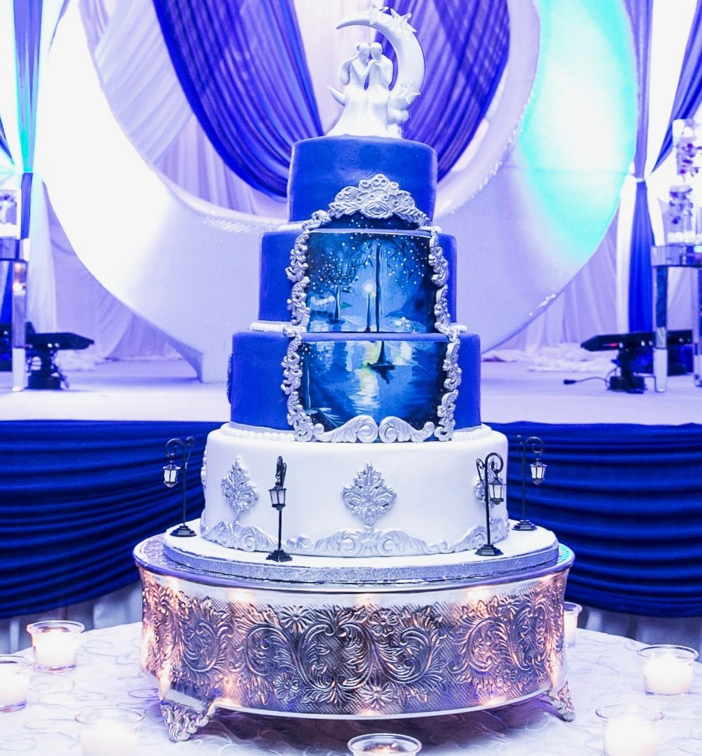 2.22.17 - Check out this Midnight Themed hand painted wedding cake by Palak's Cakes. The antique details create just the right touch!.jpg
