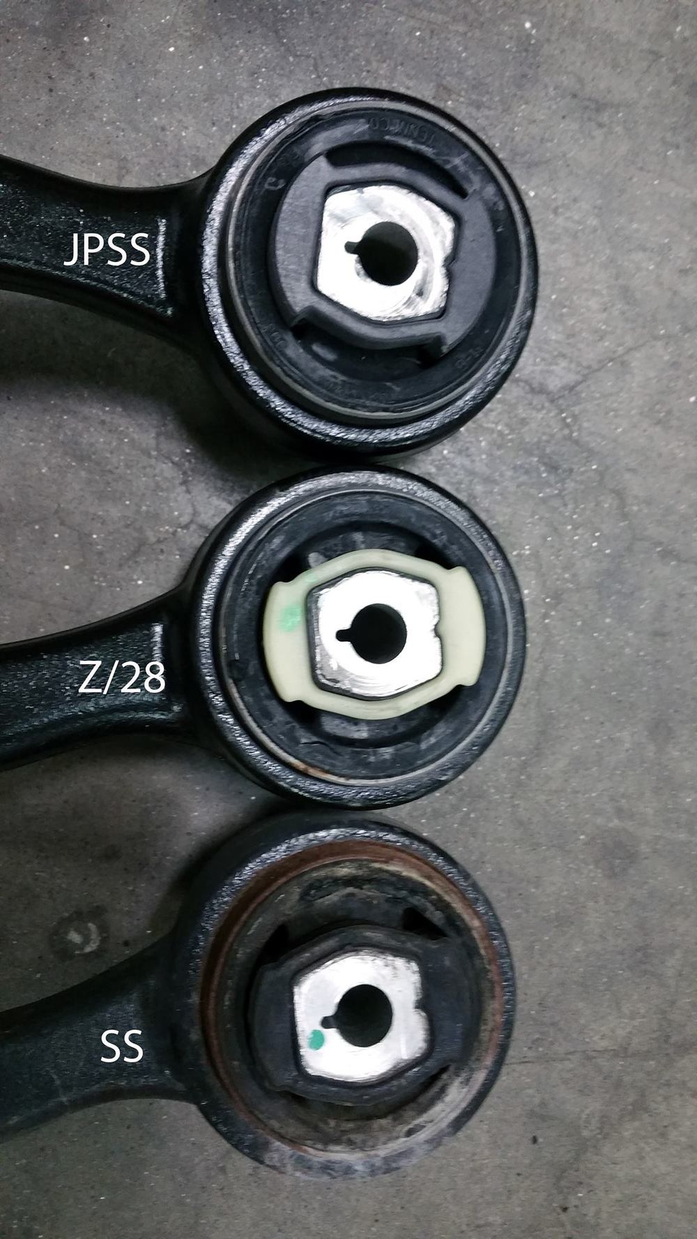 The differences in size are very clear. The SS insert is a moderately soft rubber. The Z/28 is Delrin like. The JPSS Black Magic Bushing insert is Delrin, larger than the Z/28 insert with a precision fit.