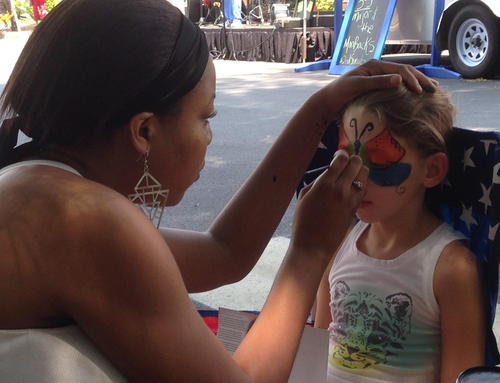 2nd Sundays July 2014 photo of Charlotte Masengale getting face Painting Susan Robertson photo.jpg