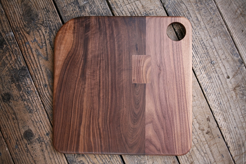 Walnut cutting board with asymmetrical corners.