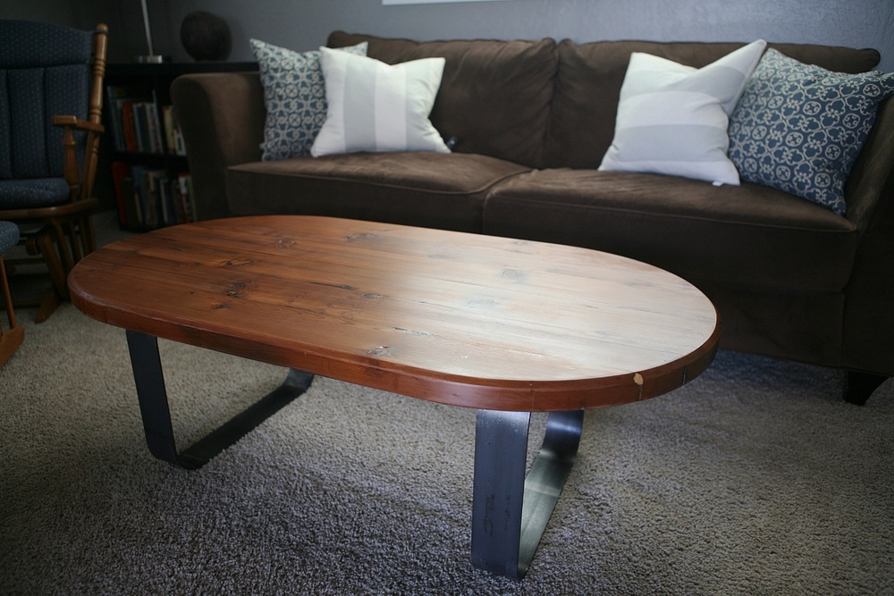 Redwood coffee table with bent steel legs.