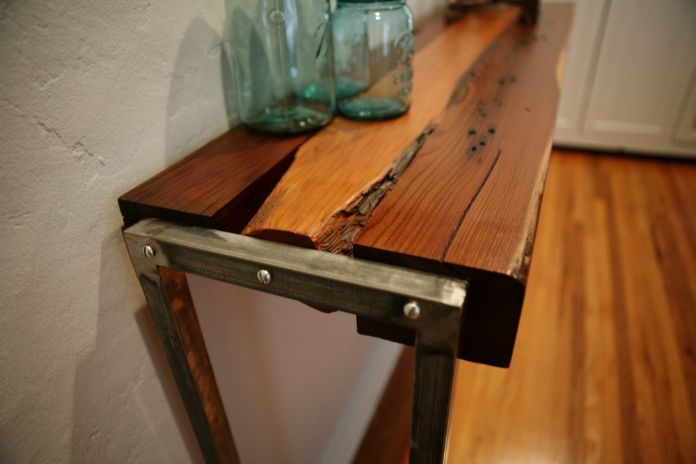 Entryway table with original farm fence post edges.