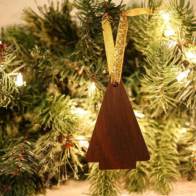 The holidays are here and we're so excited to offer our special Christmas tree ornaments in our online store. These ornaments are handmade from reclaimed walnut and we're donating 20% of each ornament sold to environmental non profits! Link to shop is in our profile!  #timberandmain