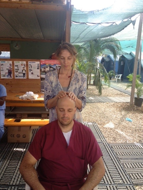 Reiki hands soothing  a tired doctor in Haiti