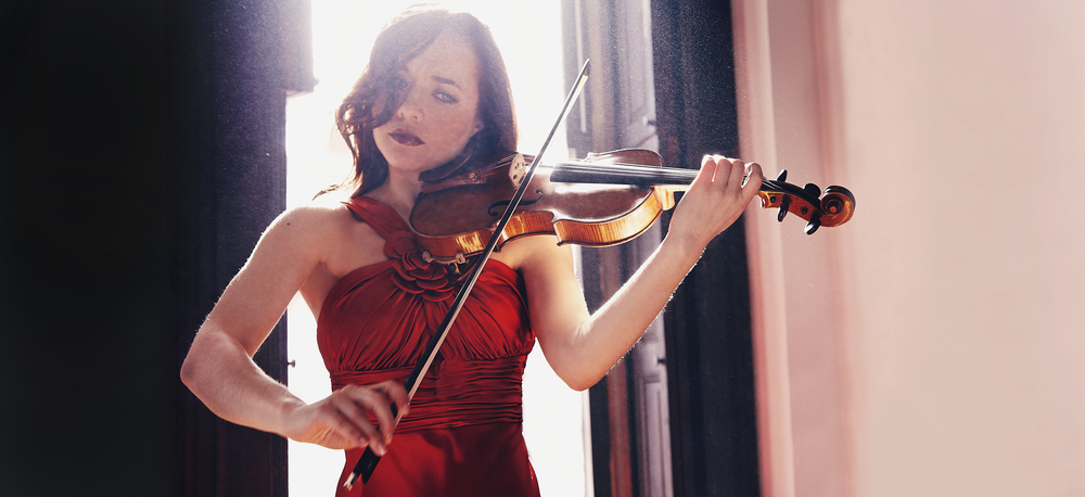 """Smith played the first violin part with poised elegance.""  - Seen & Heard International"