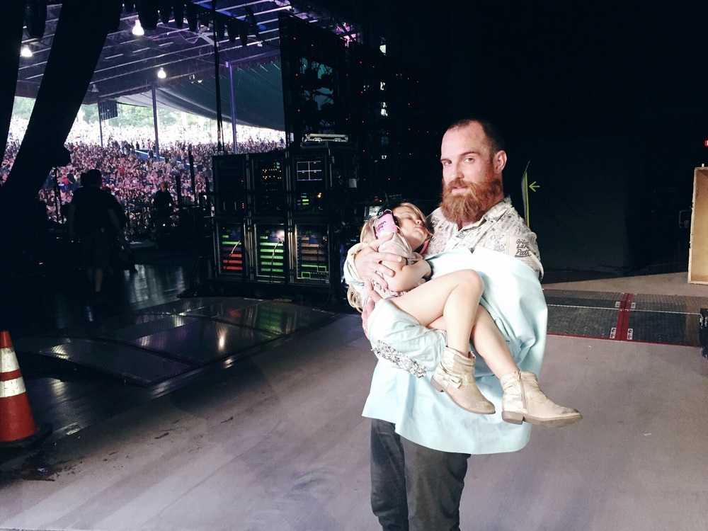 Sweet moments. She fell asleep sitting in my lap side stage. I was trapped until Darren finished his set and came and scooped her up!  Columbia, Maryland. Merriweather post pavilion.