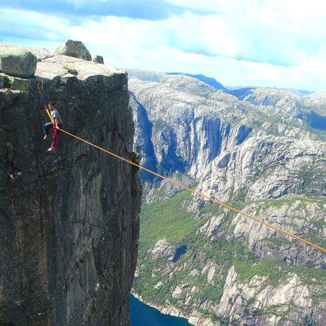 Todd on a high line 3,200 feet in mid-air between two cliffs in a Fjord in Norway.