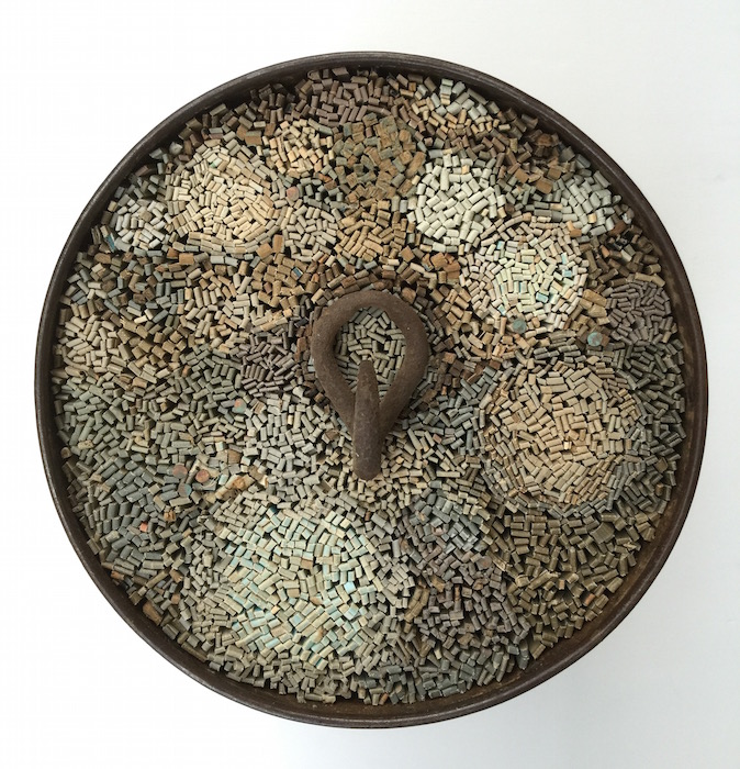 2015 'Pull of Gravity' 12_ in diameter X 8_ deep, barrel, book covers, iron, copper.jpg