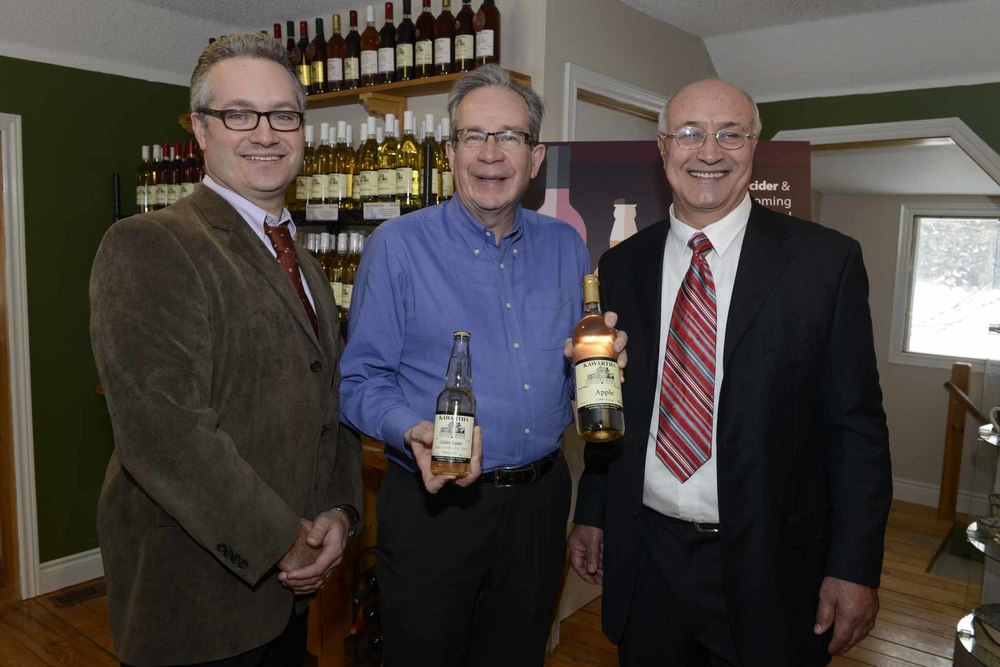 Thomas Wilson, owner of Spirit Tree Estate Cidery in Caledon and chair of the Ontario Craft Cider Association,  Ontario Agriculture, Food and Rural Affairs Minister Jeff Leal and John Rufa, owner of Kawartha Country Wines.