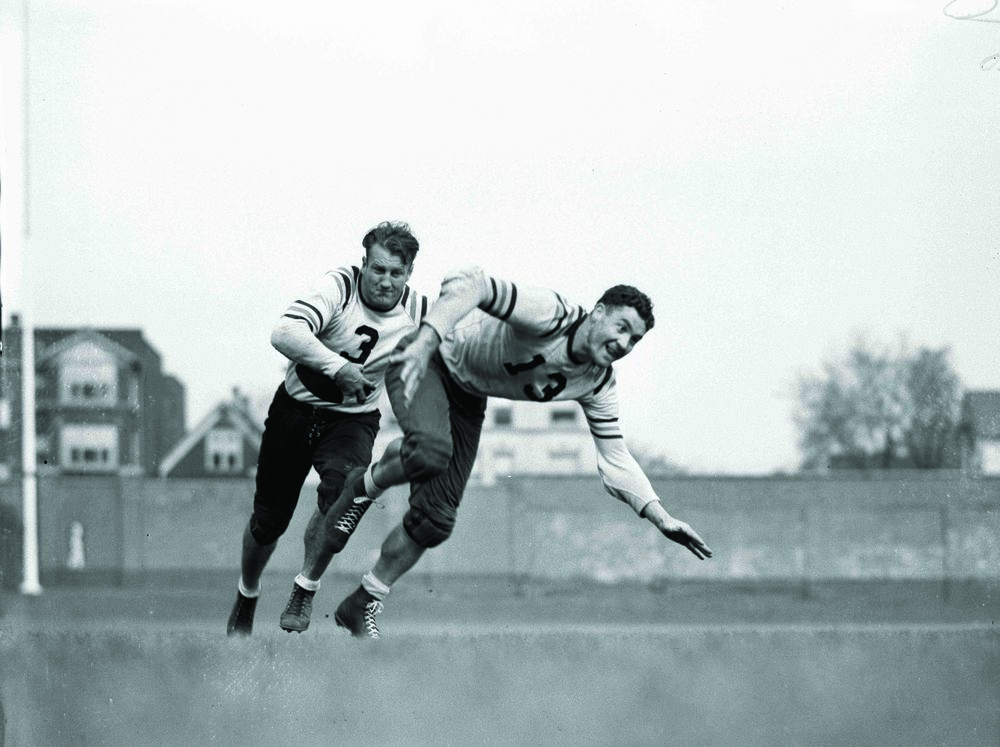 Joe Stydahar (13) practices a running play with halfback Bronko Nagurski (3).