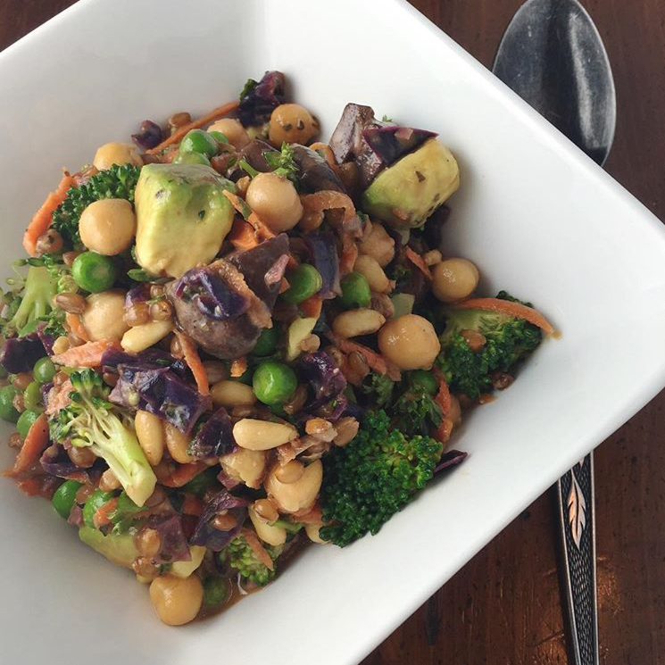 Toasted pine nuts and avocado are delicious additions to this salad, with peas, chickpeas, steamed broccoli, grated carrots, sautéed cabbage and mushrooms, wheatberries, parsley and basil and a homemade dijon balsamic vinaigrette.