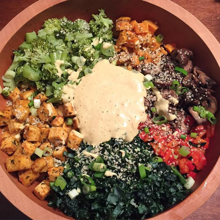 This delicious salad actually has more cooked than raw ingredients, featuring (raw) kale, fried tofu, steamed broccoli, roasted sweet potato, sautéed mushrooms, roasted red peppers, (raw) green onions and a (raw) cashew and roasted garlic dressing.